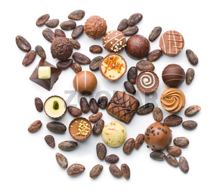 various chocolate pralines and cocoa beans