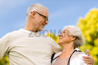 senior couple hugging in city park