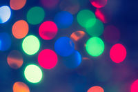 Holiday glowing Abstract Defocused Background With Blinking Lights. Blurred Bokeh. Retro Color Vintage toned photo