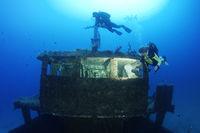 Shipwreck MV Cominoland and Scuba Diver, Gozo