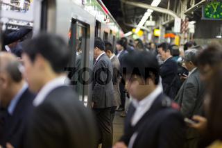 Passengers traveling by Tokyo metro.