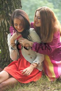 2 smiling girls