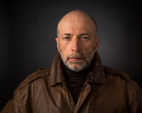 headshot of man in leather jacket
