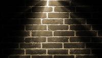 spot light yellow on brick wall