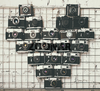 Old retro cameras in heart love photography shape