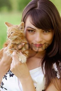 Portrait of girl with kitten