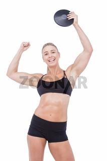 Female athlete holding discus