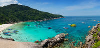Similan cove beautiful water with people and boats