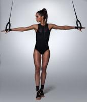 fitness woman pulling acrobatic rings