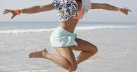 Woman Dancing Against The Sea