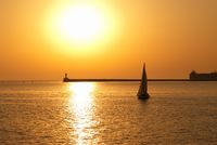 Sail boat against sunset
