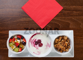 Healthy granola with yogurt and fresh fruit