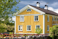 Old yellow painted farm house in Sweden