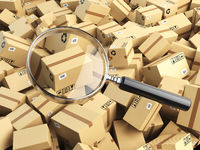 Delivery, shipping, logistics concept. Cardboard box tracking search. Loupe and boxes.
