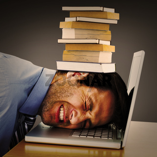 Composite image of businessman resting head on keyboard
