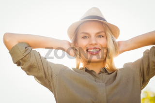 Smiling blonde with arms behind the head