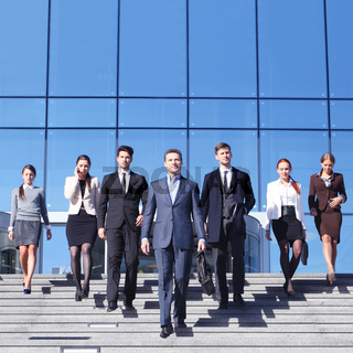 Business people at stairs