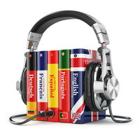 Learning languages online. Audiobooks concept. Books and headphones isolated on white.
