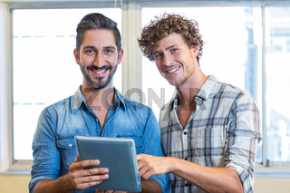 Business team looking at tablet
