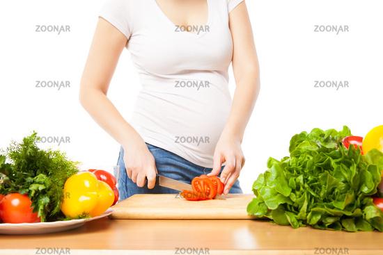 Unrecognizable woman cutting tomato