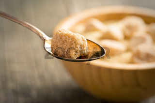 unrefined cane sugar in spoon