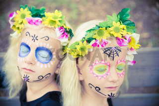 Twin halloween girls with closed eyes