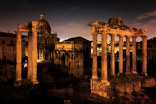The Roman Forum, Italian Foro Romano in Rome, Italy at night.