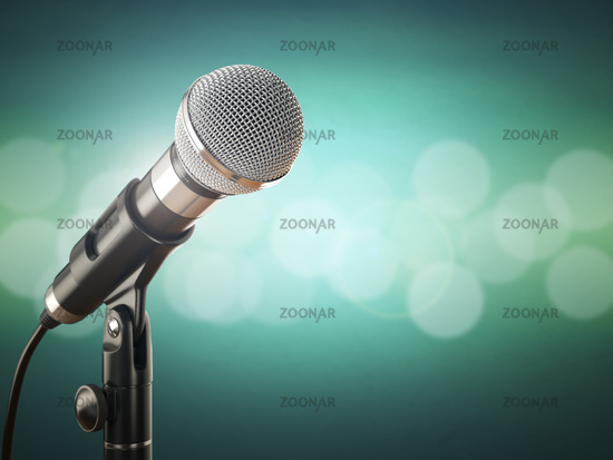 Microphone on the green abstract background.