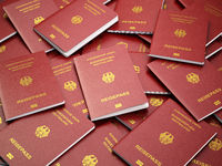 Germany passport background. Immigration or travel concept. Pile