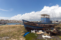 Age Trawler, lying on land, in the fishing port.