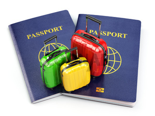 Travel or tourism concept. Passport and suitcases isolated on white.
