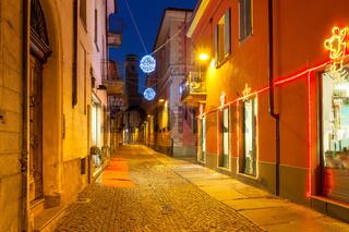 Decorated street of Alba in the evenig.