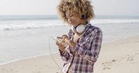 Girl On Beach Listening To Music