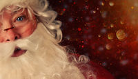 Closeup of Santa with a magical holiday background
