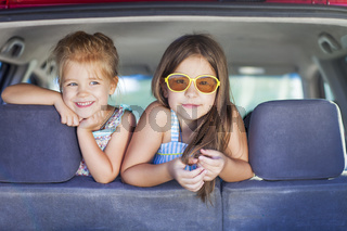 Happy kids in the car. Family on vacation