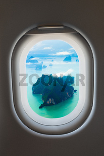 Aerial View of Rocky, Tropical Islands from a Passenger Window