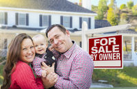 Family In Front of For Sale By Owner Sign, House