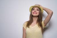 smiling brunette in pretty hat