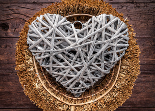 Large heart in a basket on a wooden background