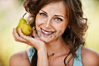 Portrait of woman holding pear