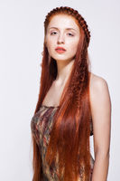 Young  woman with ginger braids hairdo on white background