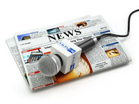 News or journalism concept. Microphone on the newspaper isolated on white.