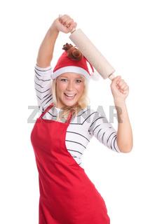 weihnachtsfrau in schürze mit einer nudelrolle