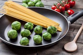 Fresh and healthy organic brussel sprouts in a frying pan