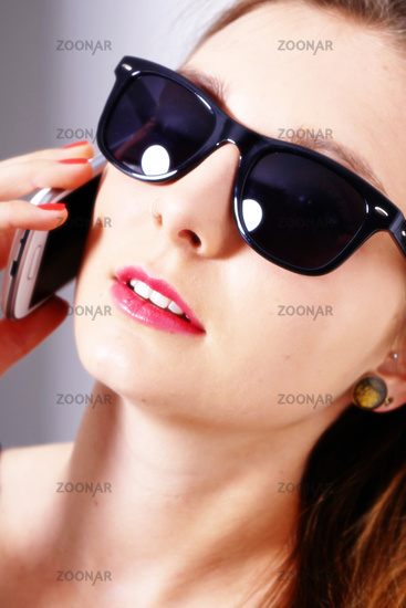 Young female with sunglasses and smartphone