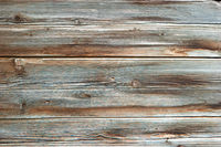 Close up of wall made of weathered wooden planks