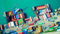 Cargo ships with containers at port terminal. Hong Kong. Tilt shift
