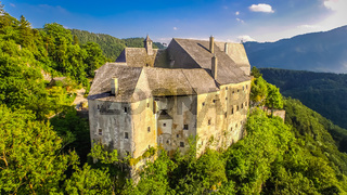 Old castle from middle age in Austria. aerial view up to the top.