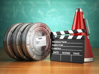 Video, movie, cinema vintage production concept. Reels, clapperboard and megaphone.