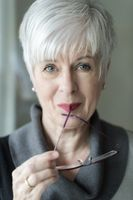 A good-looking elderly woman with gray hair and ey